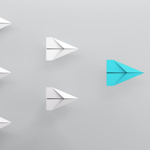 paper plane leadership concept - red paper plane leading the row